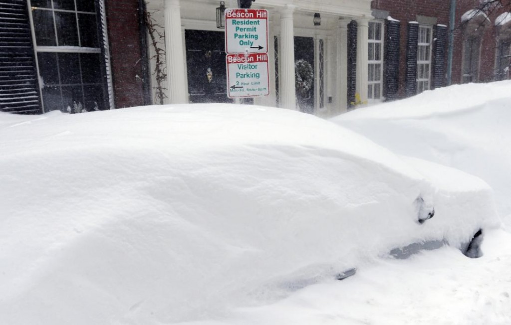 Northeast hit by blizzards, freezing cold, after record snow