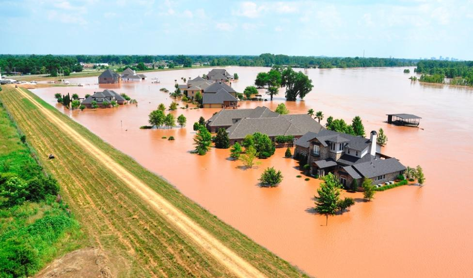 Flood waters from the Red River engulf houses in the River Bluff subdivision in Bossier City
